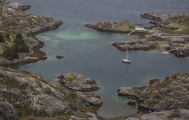 A yacht anchored amongst rocks