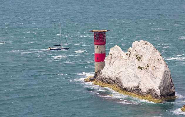 A yacht going around the Needles, Isle of Wight