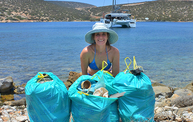 Catherine helps clean up the beach at Astypalea in the Cyclades, Greece. Credit: Nic Hodgson