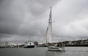 A yacht manoeuvring under sail