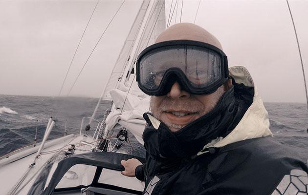 Erik Aanderaa wearing goggles while sailing in heavy weather