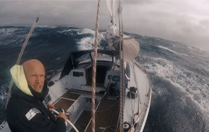 Erik Aanderaa sailing in heavy weather in his Contessa 35