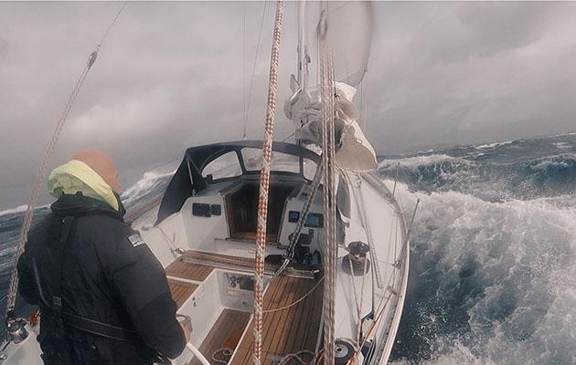 Erik Aanderaa sailing over a large wave in his Contessa 35