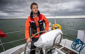 Editor of Yachting Monthly Theo Stocker helming