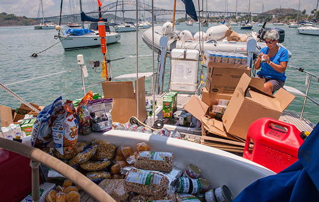 A woman sorting out food on deck