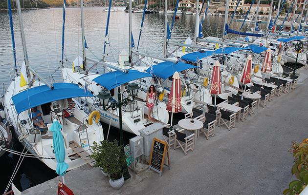 Yachts moored at a quay