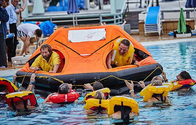 People learning to use a liferaft in a swimming pool ahead of the 2018 ARC