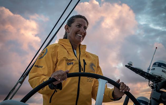 Dee Caffari helming during a leg of the Volvo Ocean Race