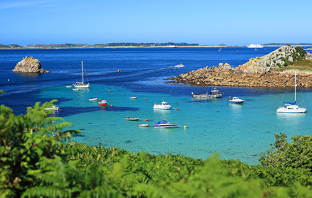 Boats anchored at Porth Conger at St Agnes, Isle of Scilly