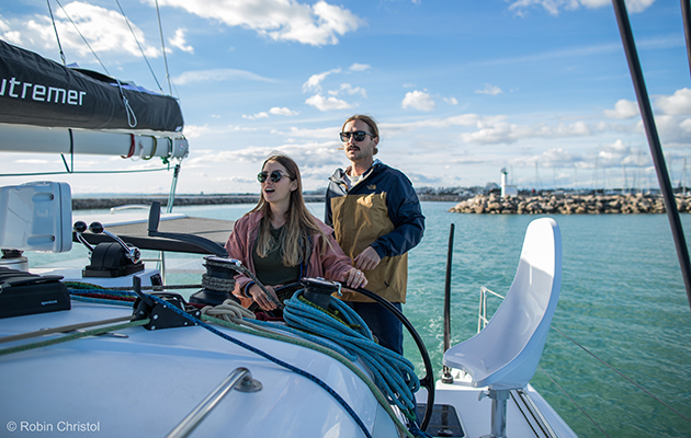 Elayna and Riley live aboard their Outremer 45 cat. With more than 1.4m subscribers to their You Tube channel, they have a reliable income stream to keep sailing. Credit: Robin Christol