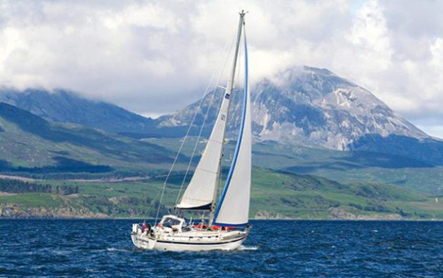 Malö 43 Imagine sails up the Sound of Jura, with the Paps of Jura in the distance.