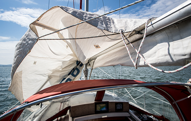 A main sail being dropped on a yacht