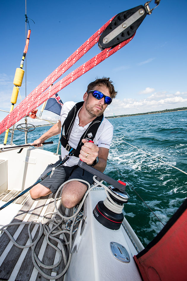 Yachting Monthly editor Theo Stocker helming a Sadler 29
