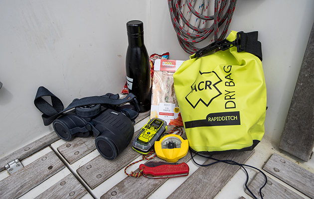 A grab bag and other gear on the deck of a Sadler 29