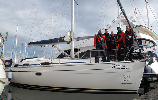 A crew of a yacht standing on the deck