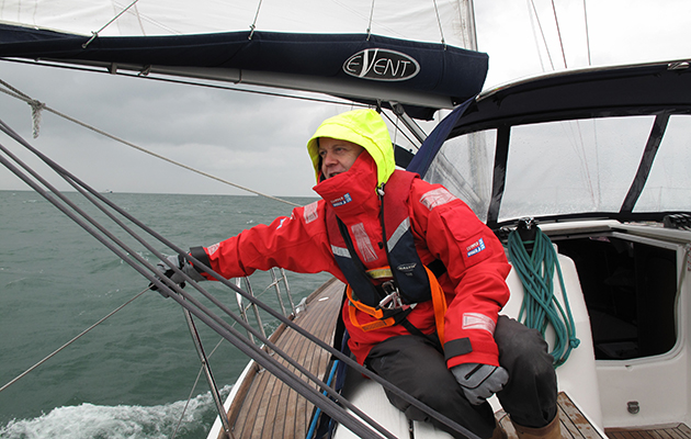 A crew member in wet weather gear