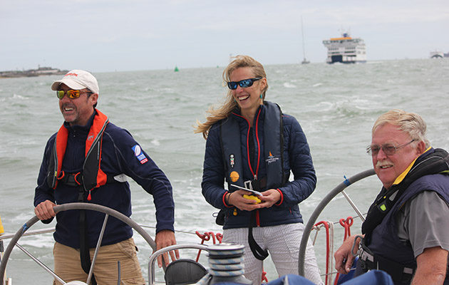 Crew laughing on a yacht in the Solent