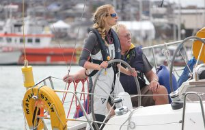 A woman during her Day Skipper course helming