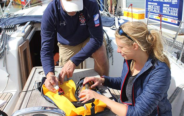 A woman checking a yellow lifejacket