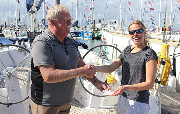 A woman being presented with a Day Skipper certificate