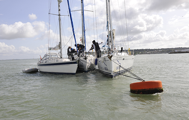 Crew preparing to leave a mooring buoy