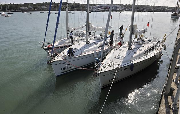 yachts rafted up alongside