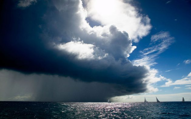 A large squall prepares to envelope a number of yachts. You might not be able to avoid it, but preparing for it appropriately will help you sail through without drama. Credit: Bluegreen Pictures / Alamy Stock Photo