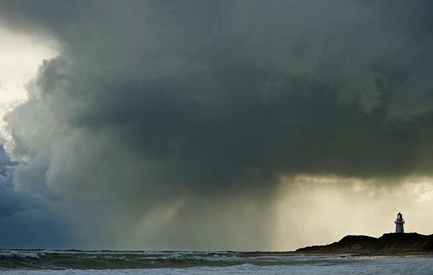 Rain clouds above a lighthouse