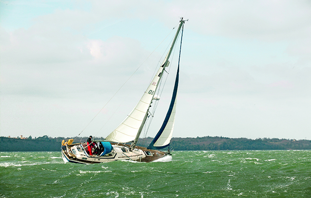 A yacht sailing in blustery conditions