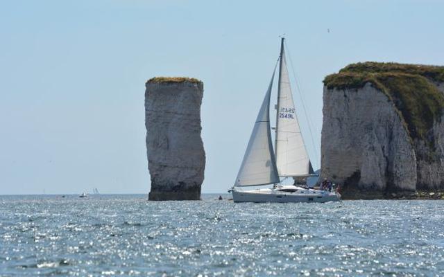 A yacht sailing in Studland Bay