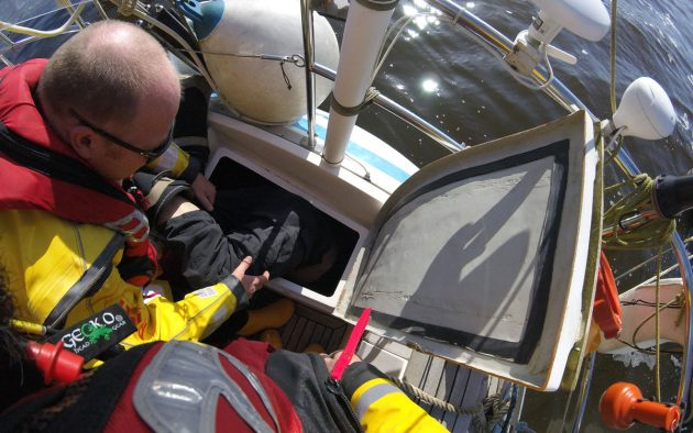 It took all three of the Lymington RNLI volunteer crew to lift Martin out of the locker. The images were captured live by the crew's helmet camera. Credit: RNLI Lymington