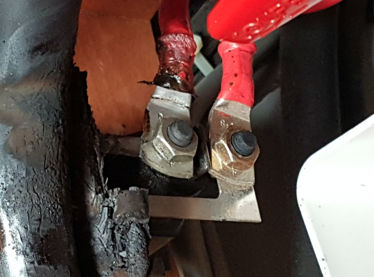 Melted red battery cables after a lightning strike on a yacht