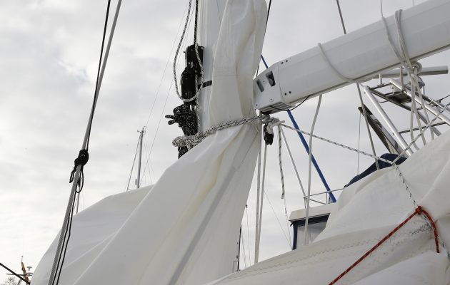 A damaged furling mainsail