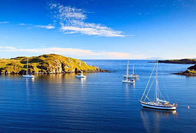 YAchts can go further afield when sailing Scotland with the Scottish islands of Harris at Loch Rodel offering a quiet anchorage