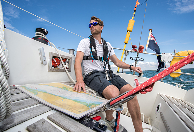 A solo sailor on a boat