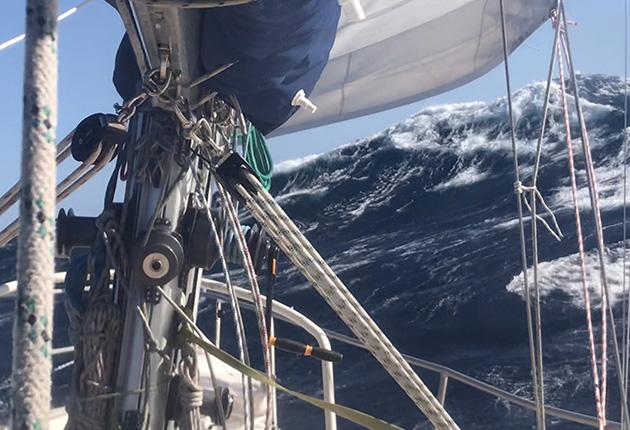 A yacht sailing through heavy seas