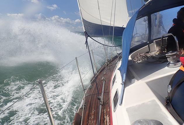 A yacht sailing through waves