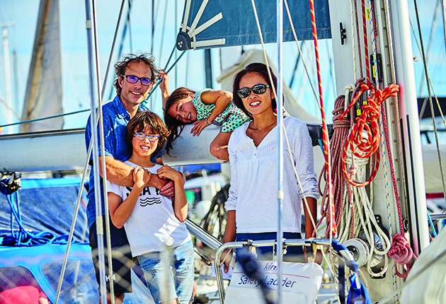 A family on the deck of their yacht before they left to cross the Atlantic