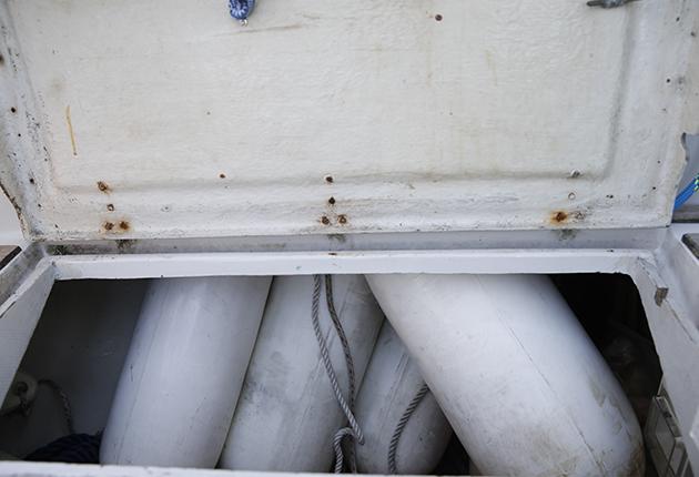 Fenders in a cockpit locker on a boat