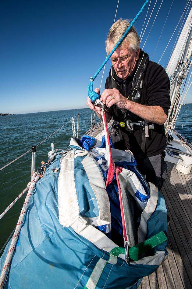 A man preparing a sail