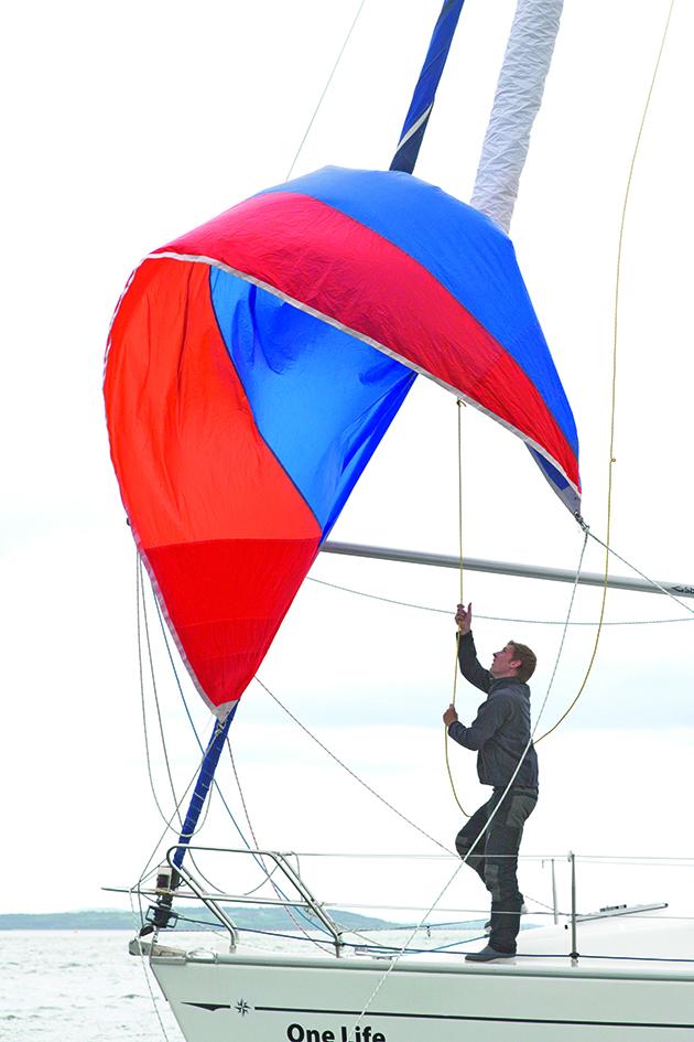 A sailor using a snuffer