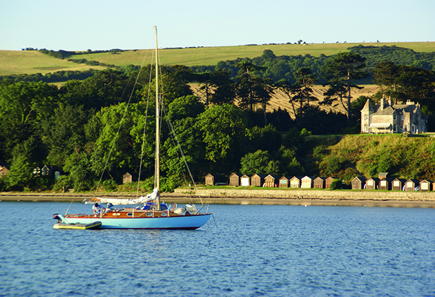 A yacht anchored in Studland Bay