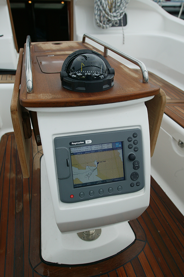 A chart plotter close to the helm of a boat. Having a electronic navigation aid close to the helm can be invaluable