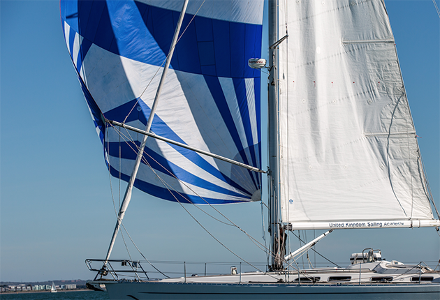 A spinnaker blowing in the wind