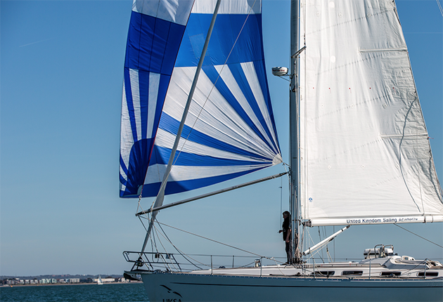 A blue and white spinnaker on a yacht