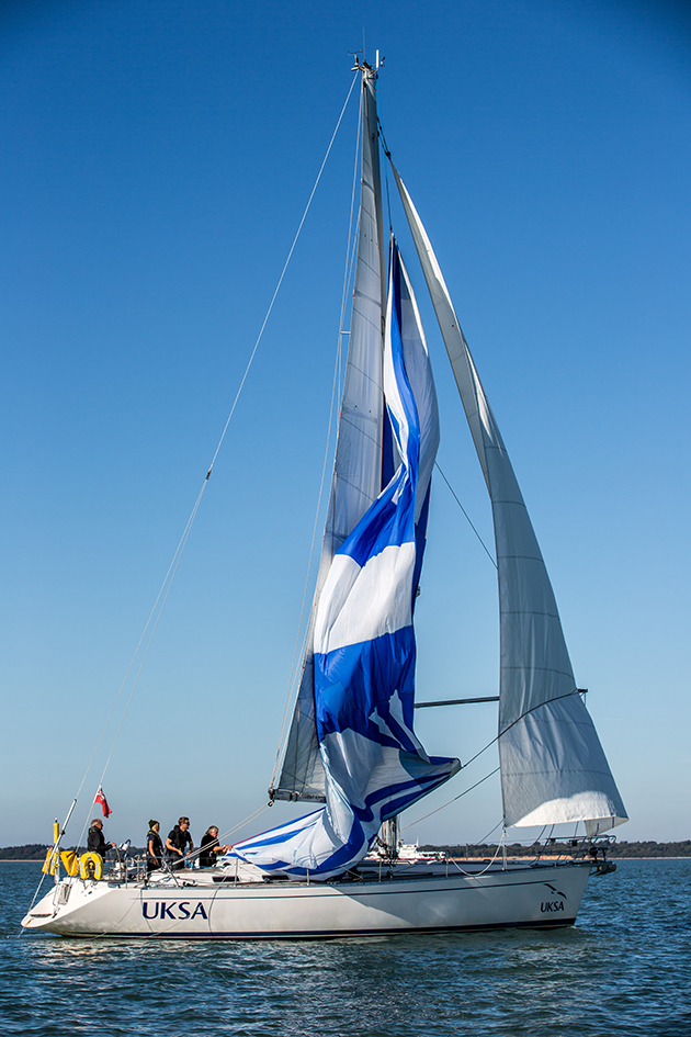 A spinnaker being dropped on a yacht