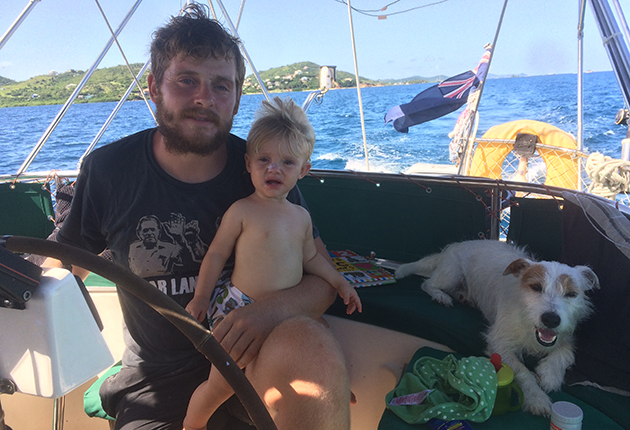 A man and his daughter on a yacht in the Caribbean