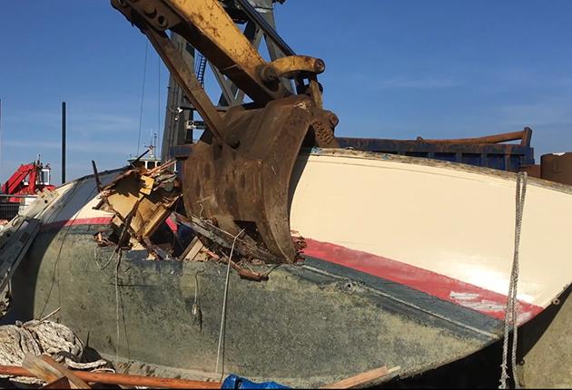 A crane crushing a yacht