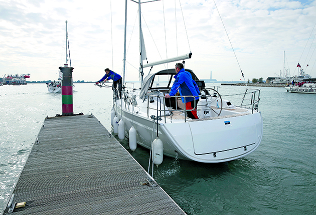 A crew working while berthing a yacht