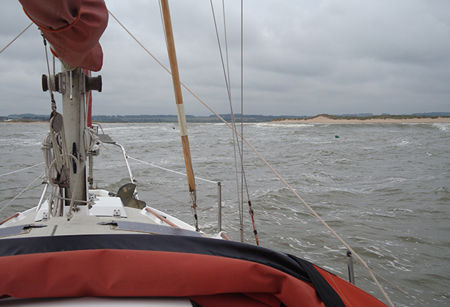 A sailor using pilotage skills to take his boat into Burnham Habour